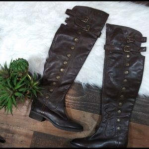 Thigh high leather brown boots with gold detailing